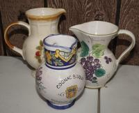 FRENCH, ITALIAN, AND JAPANESE HAND-PAINTED POTTERY PITCHERS