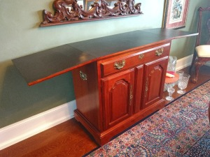 BEAUTIFUL SIDE CABINET WITH FOLD OUT TOP AND PLENTY OF STORAGE.