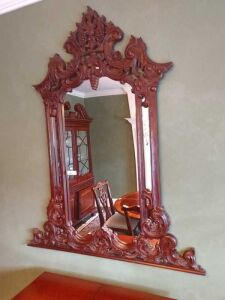 VERY NICE ORNATE WALL MIRROR. THIS ITEM WAS HANGING IN THE AREA WITH THE PREVIOUS LOT AND THE FOLLOWING 2 LOTS, IT IS A VERY NICE ACCENT PIECE AND GOES WITH THESE OTHER DINNING ROOM PIECES.