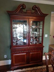 VERY BEAUTIFUL CHINA CABINET,THIS IS A 2 PIECE UNIT THAT IS VERY WELL MADE,GLASS SHELVING, THIS WAS BEING USED TO HOLD A BEAUTIFUL SET OF CHINA THAT WILL BE IN THE FOLLOWING LOTS