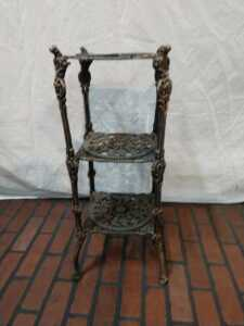 25 IN HIGH METAL PLANT STAND, ORNATE WITH THREE SHELVES