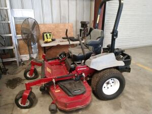 Located At The L.W.Benton Office.EXMARK ZERO TURN MOWER, 60 inch E SERIES, KAWASAKI ENGINE # FX730V, WE REPLACED THE KEY SWITCH AND THE FUEL PUMP AND MOWER OPERATES GOOD, ALSO ENGAGED THE BLADES AND MOWED SOME WITH IT. WILL NEED BATTERY AND WILL NEED STAR