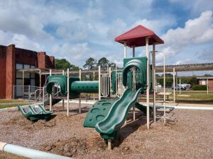Located At Bleckley County School.OUT DOOR METAL PLAYGROUND. GREAT FOR A DAYCARE OR OTHER SCHOOL.BUYER MUST REMOVE.LEGS ARE IN CONCRETE AND WILL NEED TO DIG UP OR CUT LEGS OFF FOR REMOVAL. GOOD PIECE OF EQUIPMENT JUST REALIZE THE REMOVAL PROCESS.