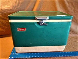 SMALL VINTAGE COLEMAN COOLER, APPROXIMATELY 18 INCH BY 11 INCH BY 13 IN, WITH METAL EXTERIOR AND HANDLES