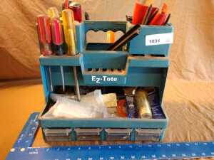 EASY TOTE WITH A VARIETY OF MISCELLANEOUS HAND TOOLS INCLUDING SCREWDRIVERS, WOOD CHISELS AND MUCH MORE