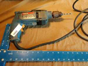 BOSCH BRAND 1/2 INCH DRILL, DOES POWER UP