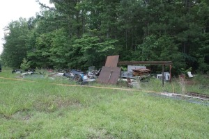 EXTREMELY LARGE LOT OF SCRAP METAL, INCLUDES AXLES, STEEL PLATE, AND MORE, ALSO METAL ON THE GROUND AROUND LOT 1044