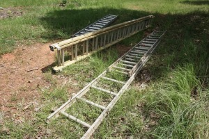 SET OF THREE EXTENSION LADDERS, TWO ARE ALUMINUM AND ONE IS FIBERGLASS