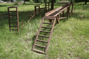 SET OF STEEL DRIVE UP CAR RAMPS, APPROXIMATELY 16 FT LONG