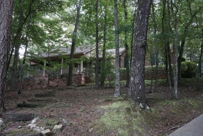 This home is spacious with 3 bedrooms, 3.5 baths, vaulted ceilings, stone fireplace, a finished basement, open floorplan, and is situated on 2 wooded residential lots in North Macon.  Property addresses are listed as 689 & 675 Lokchapee Dr., Macon, GA 312