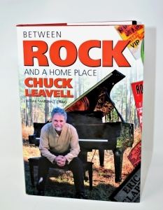 "CHUCK LEAVELL HAND AUTOGRAPHED BOOK "" BETWEEN ROCK AND A HOME PLACE"" - DONATED BY CHUCK AND ROSE LANE LEAVELL"