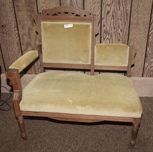 ANTIQUE UPHOLSTERED BENCH ON CASTERS