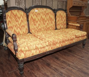 ORNATE ANTIQUE SOFA ON CASTERS