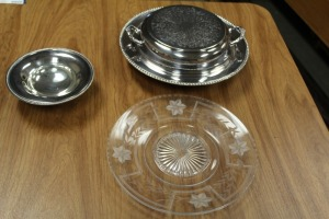 TO SILVER PLATE SERVING PIECES AND ONE ETCHED GLASS PLATE
