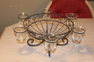 DECORATIVE METAL BOWL WITH VOTIVE CANDLE HOLDERS
