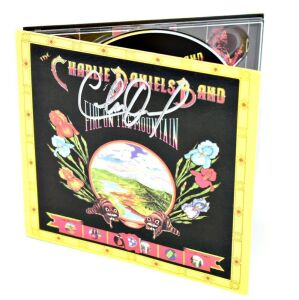 "CHARLIE DANIELS HAND AUTOGRAPHED CD ""FIRE ON THE MOUNTAIN"" WITH DICKEY BETTS ON DOBRO AND PRODUCED BY PAUL HORNSBY AT CAPRICORN RECORDS - DONATED BY MICHAEL BUFFALO SMITH"