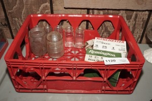 COCA-COLA CRATE WITH GLASS INSULATOR, PARTIALLY FILLED 12 GAUGE AMMUNITION, APOTHECARY BOTTLES, AND MORE
