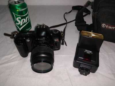 CANON EOS REBEL XS, USES FILM, ALSO INCLUDES VIVITAR FLASH