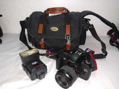 CANON EOS REBEL G WITH VIVITAR FLASH, USES FILM