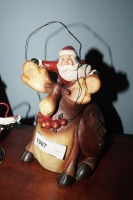 PAIR OF COMICAL SANTA CLAUS FIGURINES INCLUDING SPRING LOADED METAL - LIV - 5