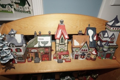 DEPARTMENT 56 SNOW VILLAGE FIGURES ON TOP SHELF MARKED 1026 - LIV