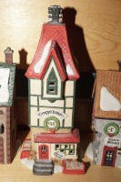 DEPARTMENT 56 SNOW VILLAGE FIGURES ON TOP SHELF MARKED 1026 - LIV - 7