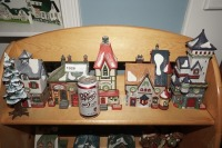 DEPARTMENT 56 SNOW VILLAGE FIGURES ON TOP SHELF MARKED 1026 - LIV - 15