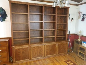 BEAUTIFUL BOOKSHELF,98-IN X 87-IN 4 SECTION, 16 SHELF WALL UNIT. HAS BOTTOM STORAGE WITH FOUR DOORS. THIS UNIT WAS HANDCRAFTED BY THE HOMEOWNER IN A LOCAL SHOP