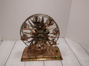 COPPER COLOR/ TIN  FERRIS WHEEL, PLACE TOYLAND, AND HAS ORIGINAL BOX, METAL SCULPTURE