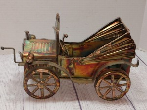 COPPER COLOR TIN METAL SCULPTURE WITH MUSIC BOX, EARLY 1900S AUTOMOBILE THEME