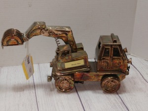 COPPER COLOR TIN METAL SCULPTURE, HEAVY EQUIPMENT TRUCK WITH SHOVEL, PLAYS WHISTLE WHILE YOU WORK