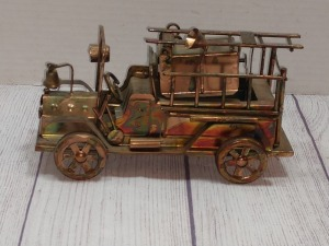COPPER COLOR TIN METAL SCULPTURE, EARLY MODEL FIRE TRUCK MUSIC BOX, BERKELEY DESIGN