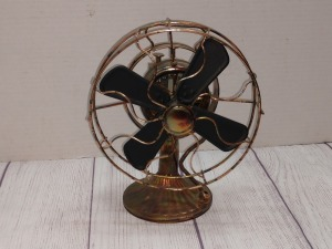 COPPER COLOR TIN METAL SCULPTURE, OLD OSCILLATING FAN, FAN DOES SPIN WHEN PLAYING MUSIC