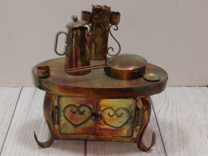 COPPER COLOR TIN METAL SCULPTURE, OLD STOVE AND OVEN WITH PAN AND COFFEE POT MUSIC BOX