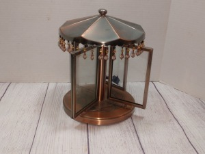 COPPER COLOR ROTATING METAL CAROUSEL, HAS FOUR ROTATING PICTURE FRAMES, NOT A MUSIC BOX