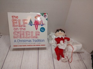 SET OF TWO ELF ON THE SHELF ONE IS STILL IN THE BOX