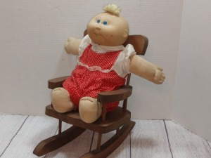 BELIEVE TO BE CABBAGE PATCH BABY IN WOODEN ROCKER