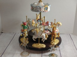 BEAUTIFUL CAROUSEL ON WOODEN TURNTABLE, HORSES ARE REMOVABLE, NOT A MUSIC BOX BUT A VERY BEAUTIFUL PIECE