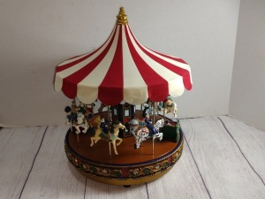 MR CHRISTMAS ELECTRIC CAROUSEL, HAS YEAR-ROUND SONG SELECTION WITH MULTIPLE SONGS, PLAYS MUSIC BUT DOES NOT TURN, MAY NEED REPAIR