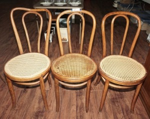 THREE OLD CANE SEAT SIDE CHAIRS