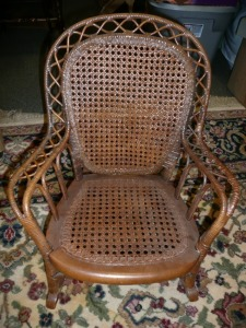 ANTIQUE CHILDREN'S CAME BACK AND BOTTOM ROCKING CHAIR