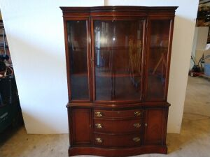 BEAUTIFUL BASSETT FURNITURE CHINA CABINET . 48IN X 15D X 69 HIGH IS IN VERY GOOD CONDITION,CURVED GLASS DOOR AND VERY NICE DRAWER PULLS WITH LOTS OF CABINET SPACE.