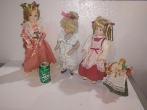 SET OF FOUR BEAUTIFUL PORCELAIN DOLLS, IN VERY GOOD CONDITION
