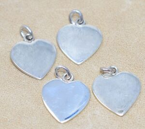 4 STERLING SILVER HEART PENDANTS / CHARMS 21.86 GRAMS