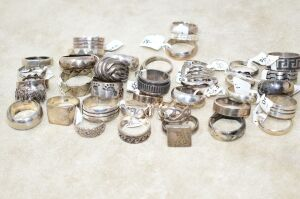 38 +/= ALL SOLID STERLING SILVER RINGS NEW CONDITION 210.00 GRAMS - GROUPED TOGETHER DUE TO LACK OF TIME TO CLEAN EACH ONE.