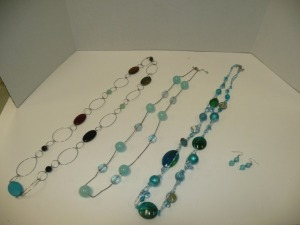 LOT OF COSTUME JEWELRY NECKLACES AND ONE PAIR OF EARRINGS