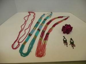 LOT OF COSTUME JEWELRY NECKLACES BRACELET AND ONE PAIR OF EARRINGS