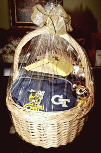 LARGE GEORGIA TECH GIFT BASKET INCLUDING ORNAMENTS, BIRD HOUSE, COLUMBIA SPORTS WEAR SHIRT AND SO MUCH MORE - DONATED BY BJ DUNWOODY