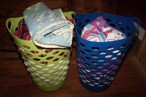 PAIR OF HAMPERS WITH BLANKETS AND QUILTS - MBR