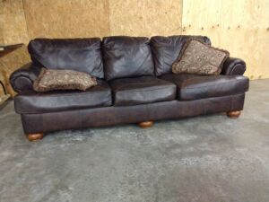 Very nice 8 ft sofa, comes with two accent pillows, leather like material, unconfirmed if true leather
